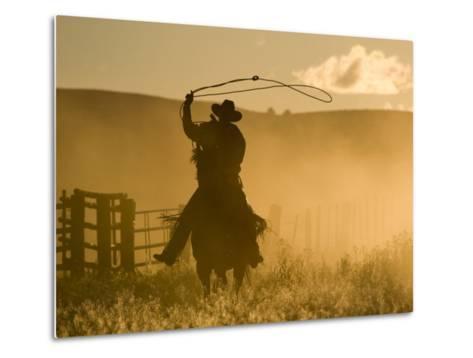 Silhouette of A Wrangler Swinging Lasso, Ponderosa Ranch, Seneca, Oregon, USA-Wendy Kaveney-Metal Print