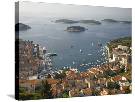 View of town and Adriatic Sea, Hvar Town, Hvar Island, Dalmatia, Croatia-John & Lisa Merrill-Stretched Canvas Print