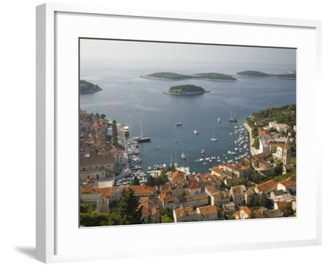 View of town and Adriatic Sea, Hvar Town, Hvar Island, Dalmatia, Croatia-John & Lisa Merrill-Framed Art Print