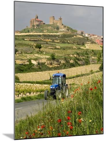 Blue tractor on rural road, San Vicente de la Sonsierra Village, La Rioja, Spain-Janis Miglavs-Mounted Photographic Print