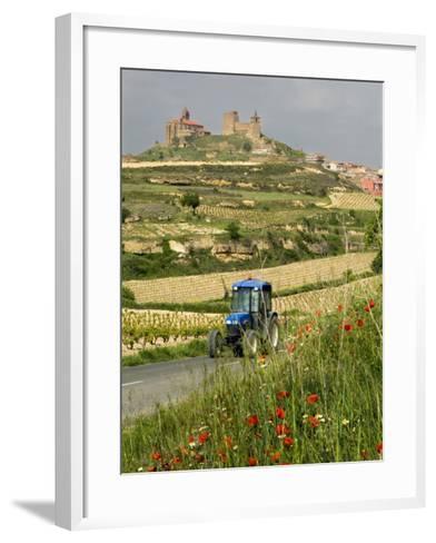 Blue tractor on rural road, San Vicente de la Sonsierra Village, La Rioja, Spain-Janis Miglavs-Framed Art Print