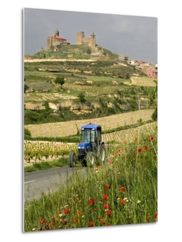 Blue tractor on rural road, San Vicente de la Sonsierra Village, La Rioja, Spain-Janis Miglavs-Metal Print
