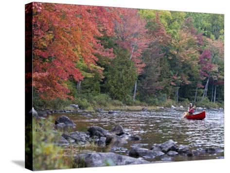 A Man Paddles His Canoe, Seboeis Lake, Millinocket, Maine, USA-Jerry & Marcy Monkman-Stretched Canvas Print