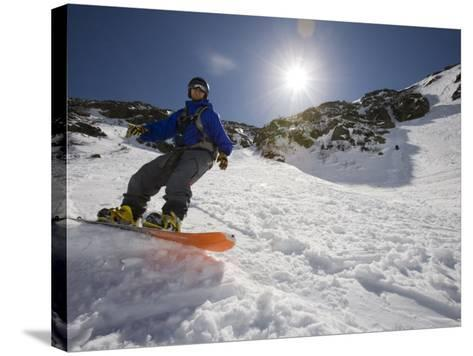Snowboarder in Tuckerman Ravine, White Mountains National Forest, New Hampshire, USA-Jerry & Marcy Monkman-Stretched Canvas Print