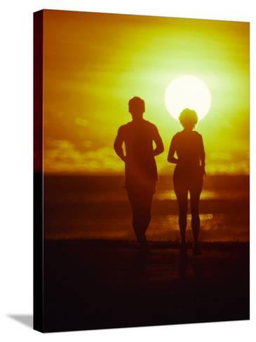 Jogging at Sunset-Douglas Peebles-Stretched Canvas Print