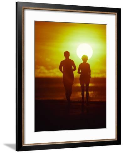 Jogging at Sunset-Douglas Peebles-Framed Art Print