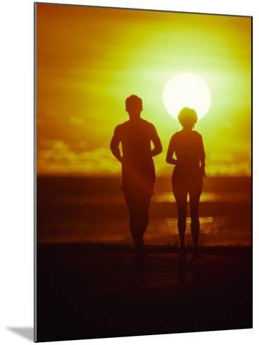 Jogging at Sunset-Douglas Peebles-Mounted Photographic Print
