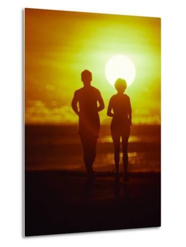 Jogging at Sunset-Douglas Peebles-Metal Print