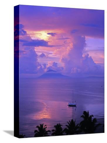 Sailboat Anchored in the Pacific Ocean at Sunset Off the Manado Coast-Greg Dale-Stretched Canvas Print