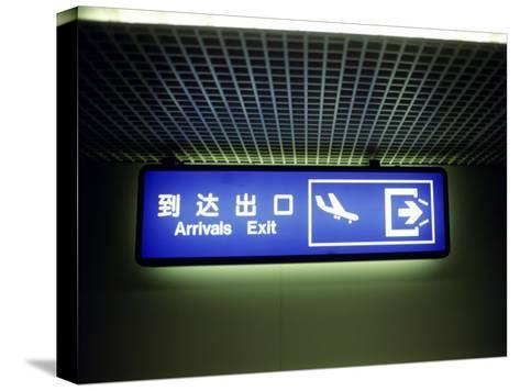 Airport Arrivals Exit Sign in Chinese and English-xPacifica-Stretched Canvas Print