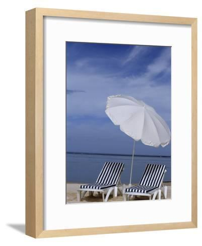 Relaxing Beach Chairs and Umbrella Await Customers-Paul Sutherland-Framed Art Print