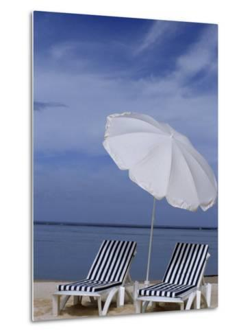 Relaxing Beach Chairs and Umbrella Await Customers-Paul Sutherland-Metal Print