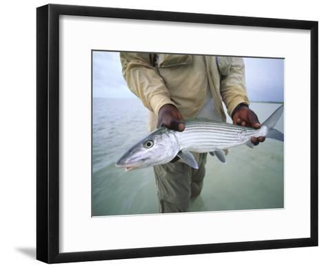 Fisherman Holds Out a Bonefish Off Great Exuma Island-Michael Melford-Framed Art Print
