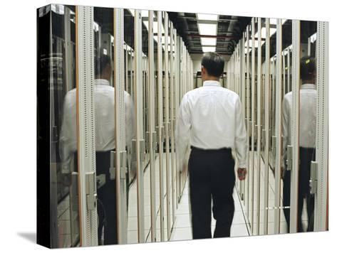 Man Walking Through a Computer Server Room-xPacifica-Stretched Canvas Print