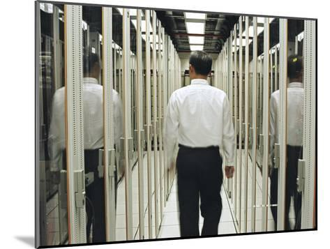 Man Walking Through a Computer Server Room-xPacifica-Mounted Photographic Print