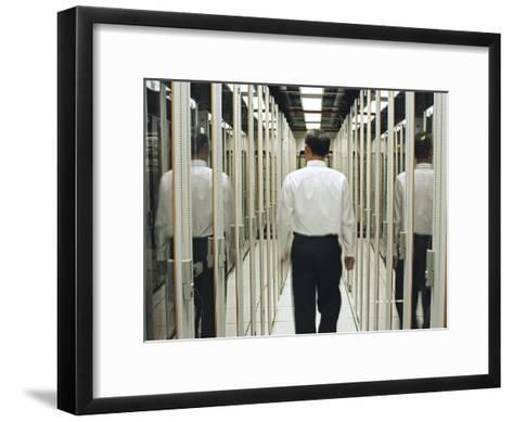 Man Walking Through a Computer Server Room-xPacifica-Framed Art Print