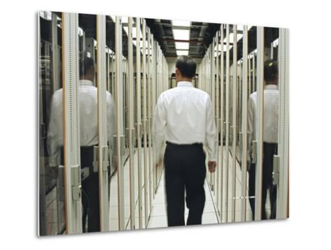 Man Walking Through a Computer Server Room-xPacifica-Metal Print