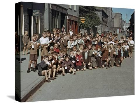 Irish School Children Eat Sweets on the Street During Recess-Howell Walker-Stretched Canvas Print