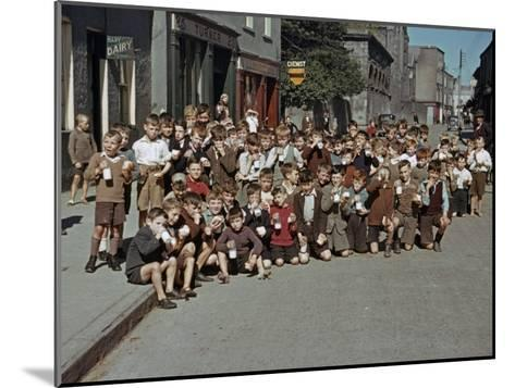Irish School Children Eat Sweets on the Street During Recess-Howell Walker-Mounted Photographic Print