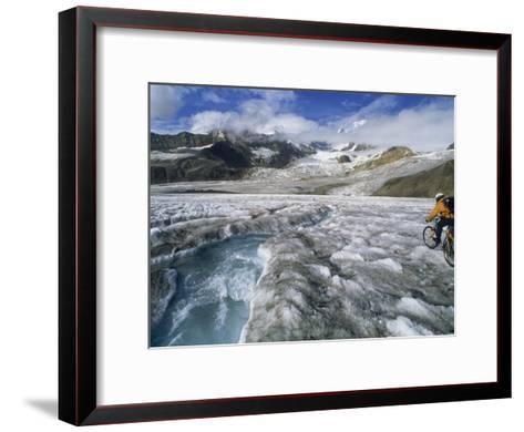Mountain Biking over Black Rapids Glacier-Bill Hatcher-Framed Art Print