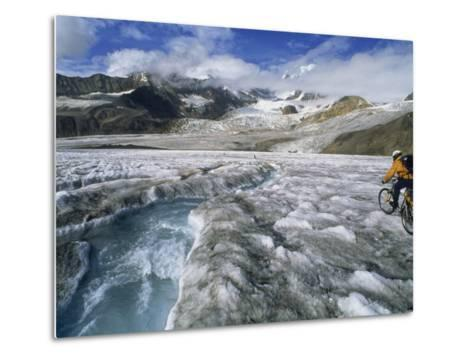 Mountain Biking over Black Rapids Glacier-Bill Hatcher-Metal Print
