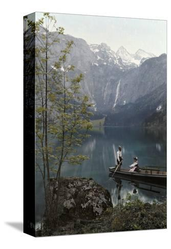 Man and Woman Row in a Boat on the Obersee Lake Near the Mountains-Hans Hildenbrand-Stretched Canvas Print