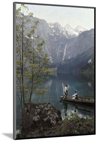 Man and Woman Row in a Boat on the Obersee Lake Near the Mountains-Hans Hildenbrand-Mounted Photographic Print