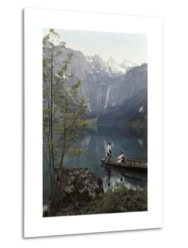 Man and Woman Row in a Boat on the Obersee Lake Near the Mountains-Hans Hildenbrand-Metal Print