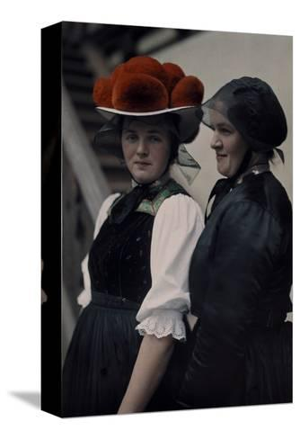 Two Gutach Women Pose Wearing a Black Bonnet and a Pompon Hat-Hans Hildenbrand-Stretched Canvas Print