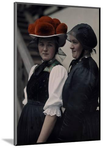 Two Gutach Women Pose Wearing a Black Bonnet and a Pompon Hat-Hans Hildenbrand-Mounted Photographic Print