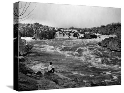 Man Watches as the Potomac River Rushes by Him-Edwin L^ Wisherd-Stretched Canvas Print