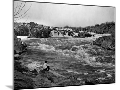 Man Watches as the Potomac River Rushes by Him-Edwin L^ Wisherd-Mounted Photographic Print