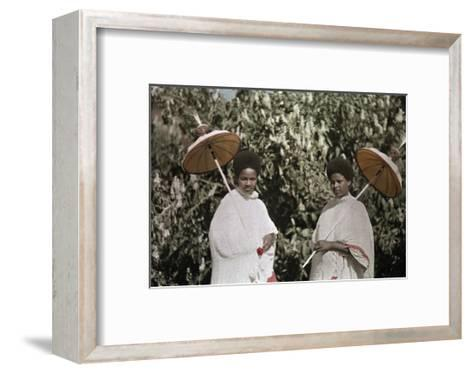 Two Amharic Women Pose Holding Umbrellas to Shade Themselves-W^ Robert Moore-Framed Art Print