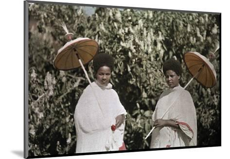 Two Amharic Women Pose Holding Umbrellas to Shade Themselves-W^ Robert Moore-Mounted Photographic Print
