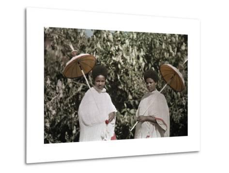 Two Amharic Women Pose Holding Umbrellas to Shade Themselves-W^ Robert Moore-Metal Print