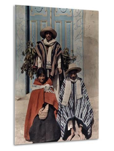 Three Poncho-Clad Quichua Indians Stand in Front of a Colorful Door-Jacob Gayer-Metal Print