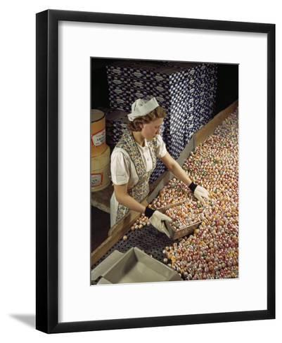 Factory Worker Sorts Through Candy on a Conveyor Belt-Willard Culver-Framed Art Print