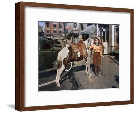 Cowgirl Puts a Nickel in an El Paso Parking Meter to Hitch Her Pony-Luis Marden-Framed Art Print