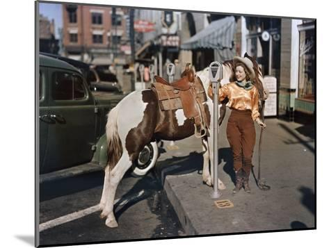 Cowgirl Puts a Nickel in an El Paso Parking Meter to Hitch Her Pony-Luis Marden-Mounted Photographic Print