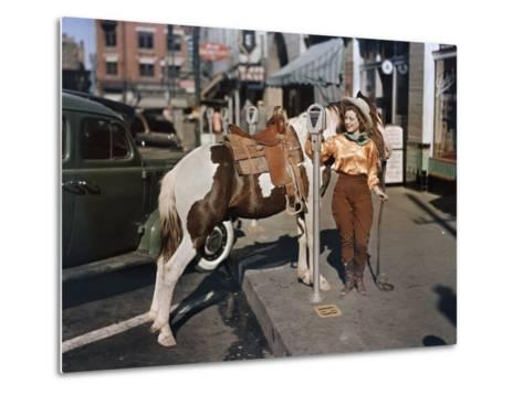 Cowgirl Puts a Nickel in an El Paso Parking Meter to Hitch Her Pony-Luis Marden-Metal Print