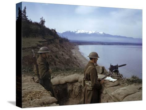 American Soldiers Guard the Coast with a Machine Gun in a Trench-Joseph Baylor Roberts-Stretched Canvas Print