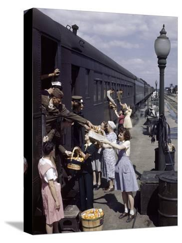 Farm Women Give Gifts of Food to Service Men Traveling by Train-B^ Anthony Stewart-Stretched Canvas Print