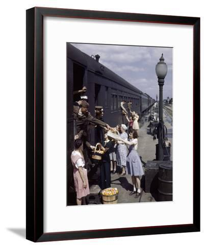 Farm Women Give Gifts of Food to Service Men Traveling by Train-B^ Anthony Stewart-Framed Art Print