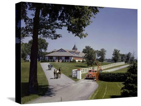 View of the Grounds at Calumet Farm, Where Race Horses are Held-B^ Anthony Stewart-Stretched Canvas Print