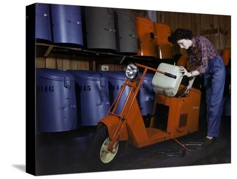 Woman Works on a Cushman Scooter for the War Effort-B^ Anthony Stewart-Stretched Canvas Print