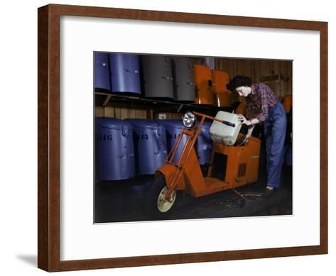 Woman Works on a Cushman Scooter for the War Effort-B^ Anthony Stewart-Framed Art Print