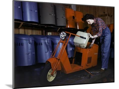 Woman Works on a Cushman Scooter for the War Effort-B^ Anthony Stewart-Mounted Photographic Print