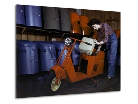 Woman Works on a Cushman Scooter for the War Effort-B^ Anthony Stewart-Metal Print