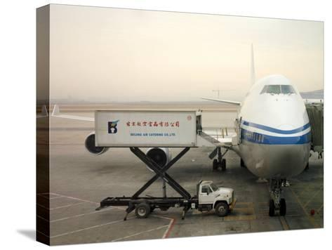 Cargo Is Loaded onto a Plane at the Beijing International Airport-xPacifica-Stretched Canvas Print