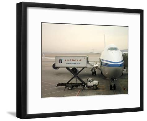 Cargo Is Loaded onto a Plane at the Beijing International Airport-xPacifica-Framed Art Print